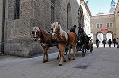 salzburg – march 13: horse driven carriage with tourists near the franciscan - stock photo