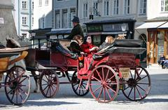 Salzburg – march 13: horse driven carriage with tourists at spring days, vis Stock Photos