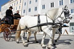 salzburg – march 13: horse driven carriage with tourists at spring days, vis - stock photo