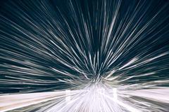 Speedy snowflakes seen through windscreen - stock photo