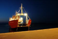 Ferryboat arrives to the dock Stock Photos