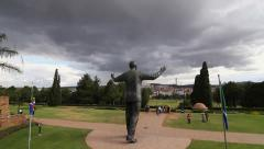 Statue of Nelson Mandela with storm clouds Stock Footage