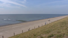 View from sea dike at North Sea pan polder behind dike Stock Footage