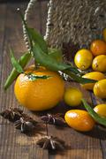 Tangerine (Citrus reticulata), kumquats and star anise (Illicium verum) on Stock Photos