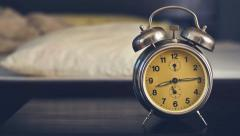 Vintage alarm clock in bedroom - stock footage
