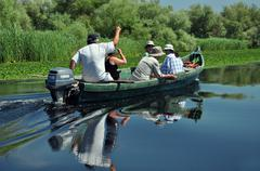 Birdwatching boat trip in the Danube delta - stock photo