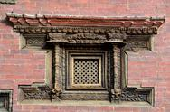 Stock Photo of Carved wooden window in Nepal