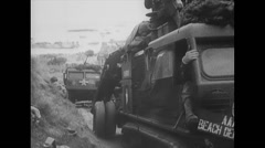 WW2 - US Navy - D Day - Troops 01 - Driving Of Beach Stock Footage