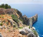 Stock Photo of rocky headland in sea and fortress wall in alanya
