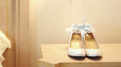 Wedding accessories and bridal shoes on the table Stock Footage