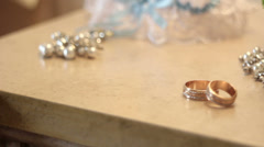 Bridal bouquet and gold rings on the table Stock Footage