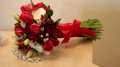 Bridal bouquet of red roses and rings on the table Stock Footage