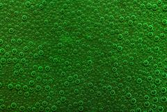 underwater background with lots of small air bubbles in green ambiance - stock photo
