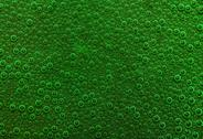 Stock Photo of underwater background with lots of small air bubbles in green ambiance