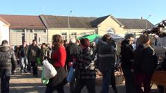 Panorama people buy various goods in outdoor market fair bazaar Stock Footage