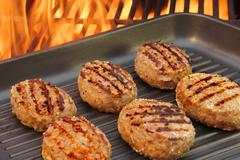 burger put on the grill pan xxxl - stock photo