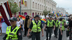 Policeman force protect public loudly gay parade participants Stock Footage