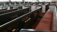 Stock Video Footage of Slow camera move (dolly) shot along church pews