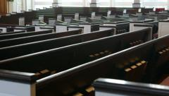 Slow tracking (dolly) shot along church pews Stock Footage