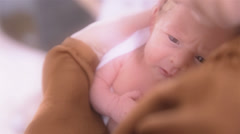Newborn Baby With Big Eyes in Mothers Arms Stock Footage