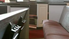 Close-up shot slowly moving past pews in a church Stock Footage