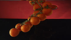 Tomatoes on a branch under water in slowmotion Stock Footage