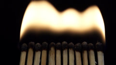Blow out the fire matches in slowmotion Stock Footage