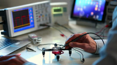 Adjusting quadrocopter electronic laboratory Stock Footage