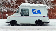 Post Office mail truck, winter snowfall Stock Footage