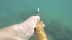 Extreme underwater hunting Stock Footage