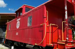 old fashioned red train caboose - stock photo