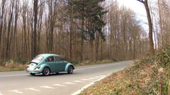 Old and new beetles on the road. Stock Footage