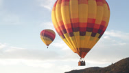 Stock Video Footage of Balloon tilt up pan right to sky hot air balloons in california wine country