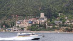 Ship sails along peninsula of Athos, autonomous monastic state in Greece Stock Footage