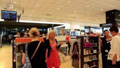 People inside duty free store Stock Footage