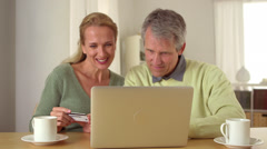 Mature couple planning vacation getaway Stock Footage