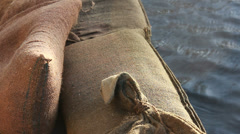 Close up sandbags next to flooded waters Stock Footage