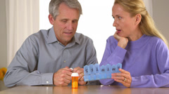 Senior couple organizing pills together - stock footage