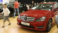 Stock Video Footage of Red Mercedes-Benz C-class at automotive-show