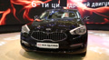 Black KIA Quoris at automotive-show Footage