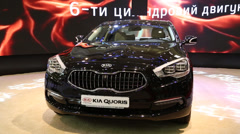 Black KIA Quoris at automotive-show Stock Footage