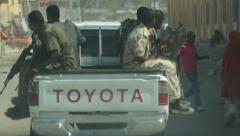 Pickup truck filled with armed somali soldiers Stock Footage