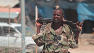 Stock Video Footage of Somali soldier relaxing with AK-47