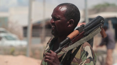 Somali soldier standing with an AK-47  Stock Footage
