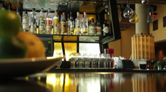 A bar tender tracks the wine bar which contains fruits on the plate Stock Footage