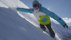 SLOW MOTION: Snowboarder boarding in fresh snow - stock footage
