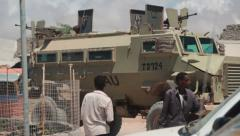 An Africa Union military MRAP (Mine Resistant Ambush Protected) vehicle passes Stock Footage
