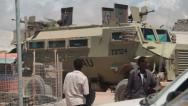 Stock Video Footage of An Africa Union military MRAP (Mine Resistant Ambush Protected) vehicle passes