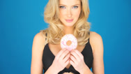Stock Video Footage of Beautiful blond woman eating a big doughnut