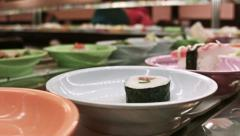 0275 Sushi restaurant, running sushi Stock Footage